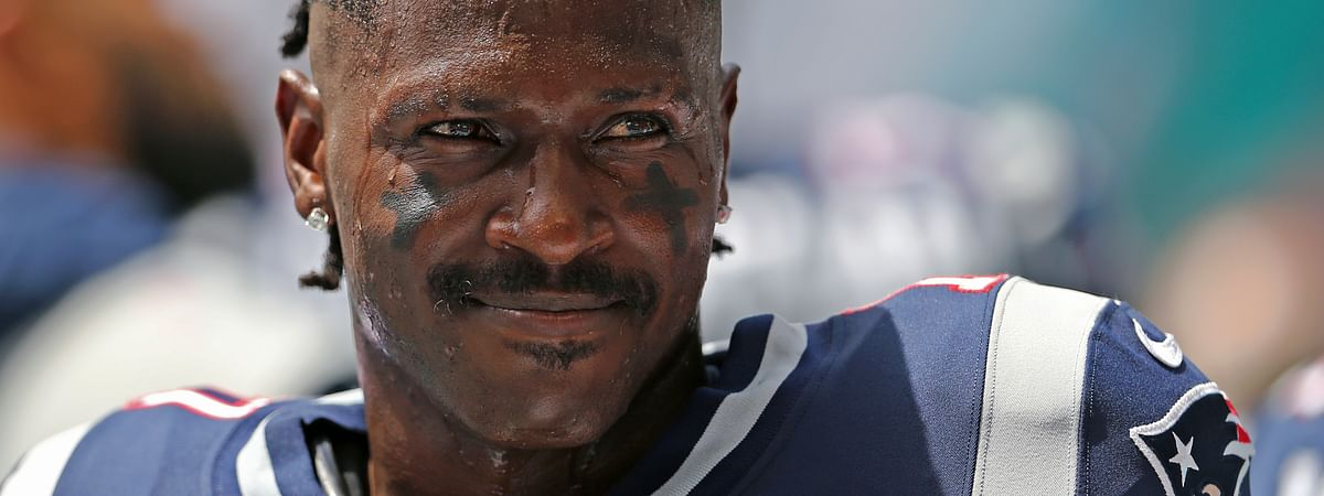 New England Patriots wide receiver Antonio Brown looks on before the start of an NFL football game against the Miami Dolphins at Hard Rock Stadium on Sunday, September 15 2019, in Miami Gardens.