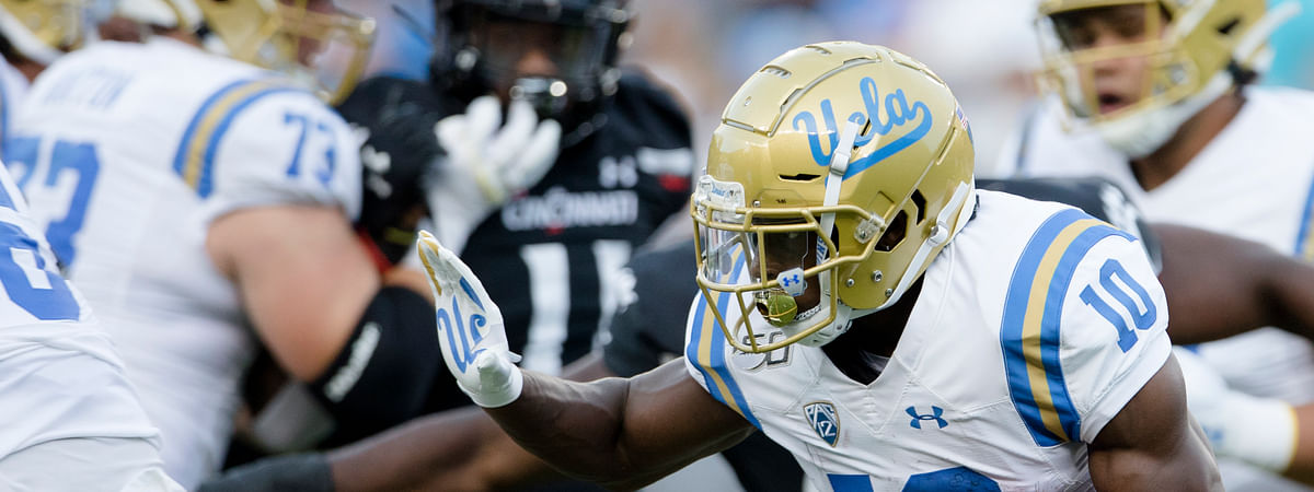 UCLA wide receiver Demetric Felton (10) runs with the ball against Cincinnati during the first half of an NCAA college football game Thursday, Aug. 29, 2019, in Cincinnati. (Albert Cesare/The Cincinnati Enquirer via AP)