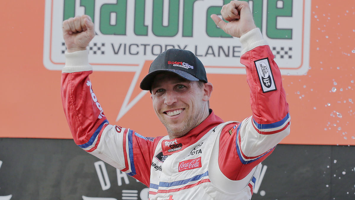 Denny Hamlin celebrates in Victory Lane after winning a NASCAR Xfinity Series auto race on Saturday, Aug. 31, 2019, at Darlington Raceway in Darlington, S.C. Hamlin was stripped of his win after he failed post-race inspection. Cole Custer was declared the winner. (AP Photo/Terry Renna)