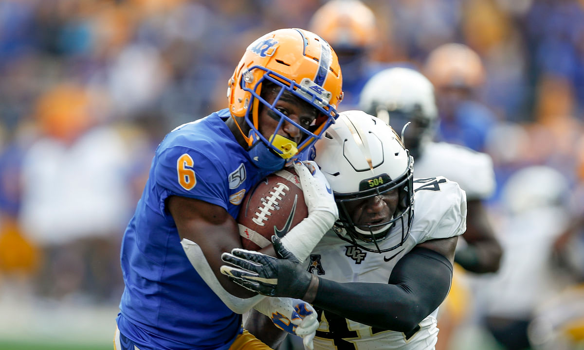 Pittsburgh wide receiver Aaron Mathews (6) tries to get away from Central Florida linebacker Nate Evans (44) after making a catch during the first half of an NCAA college football game, Saturday, Sept. 21, 2019, in Pittsburgh.
