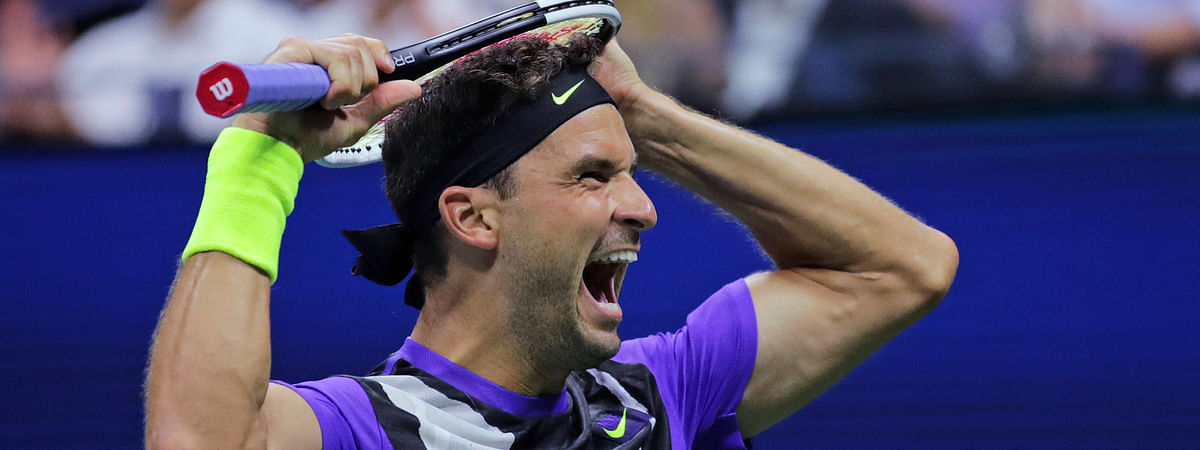Grigor Dimitrov, of Bulgaria, reacts after defeating Roger Federer, of Switzerland, during the quarterfinals of the U.S. Open tennis tournament Tuesday, Sept. 3, 2019, in New York. Dimitrov won 3-6, 6-4, 6-3, 6-4, 6-2. (AP Photo/Charles Krupa)