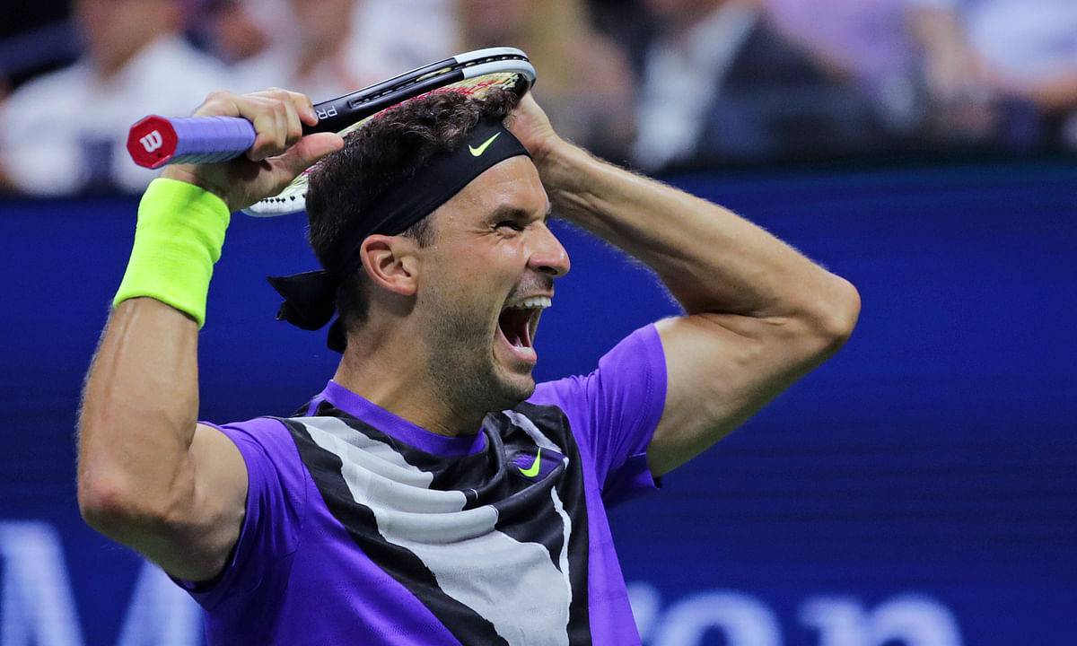 Grigor Dimitrov wears out a stunned Roger Federer in 5-set victory in U.S. Open quarterfinals