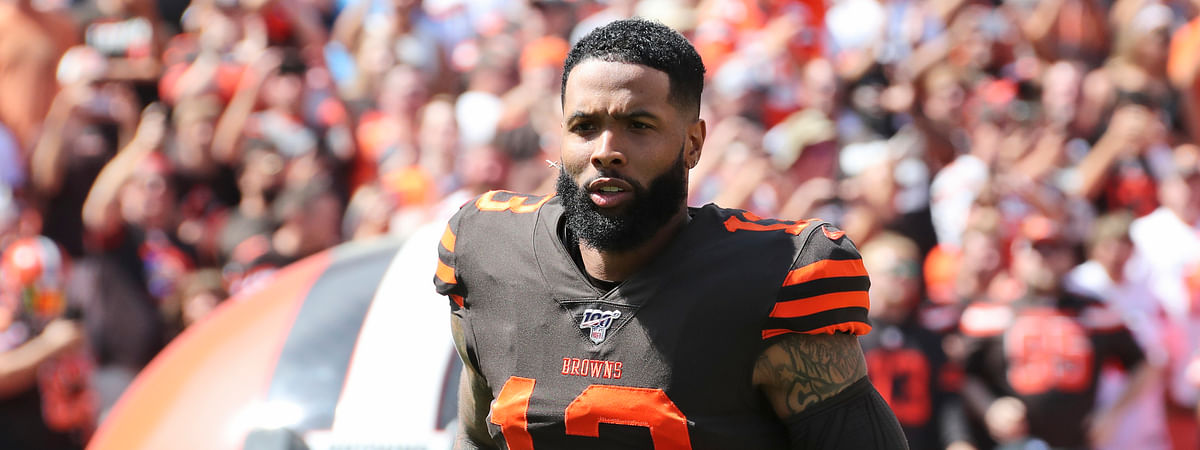 In this Sunday, Sept. 8, 2019, file photo, Cleveland Browns wide receiver Odell Beckham Jr. is introduced as he runs out on the field before an NFL football game against the Tennessee Titans, in Cleveland.
