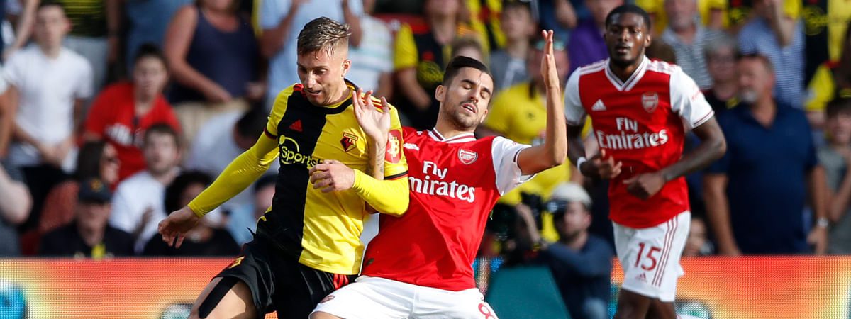 Watford's Gerard Deulofeu, left, vies for the ball with Arsenal's Dani Ceballos during their English Premier League soccer match between Watford and Arsenal at the Vicarage Road stadium in Watford near London, Sunday, Sept. 15, 2019.