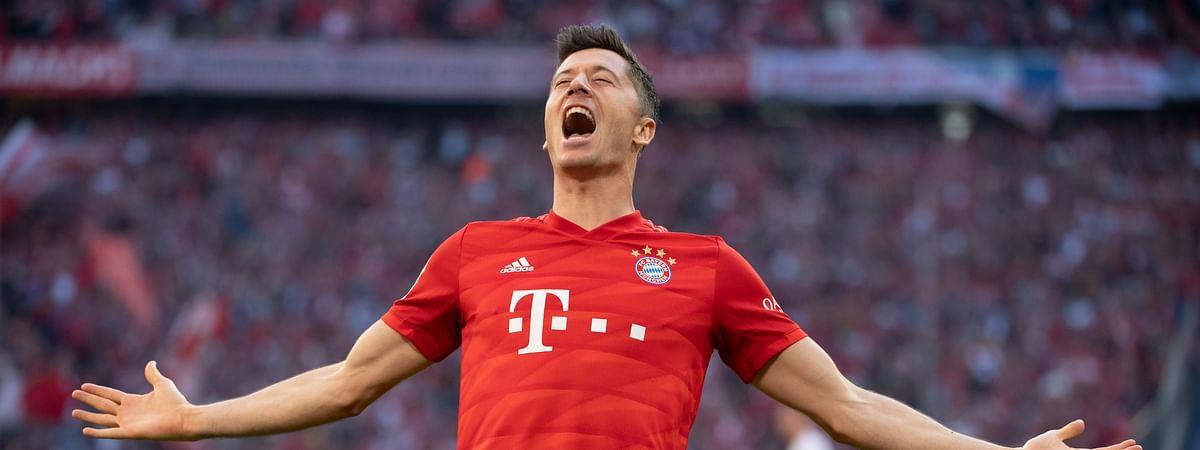Munich's Robert Lewandowski celebrates after scoring his side second goal during the German Bundesliga soccer match between FC Bayern Munich and 1. FC Union Berlin in Munich, Saturday, Oct. 26, 2019.
