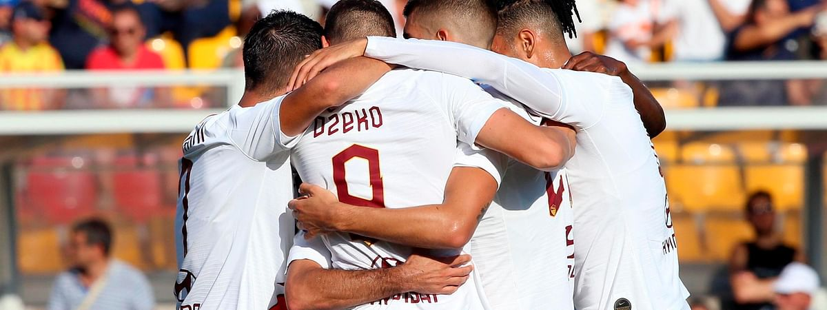 Roma's Edin Dzeko, center, back to camera, celebrates with his teammates after scoring during the Italian Serie A soccer match between Lecce and Roma at the Via del Mare stadium in Lecce, Italy, Saunday, Sept. 29, 2019.