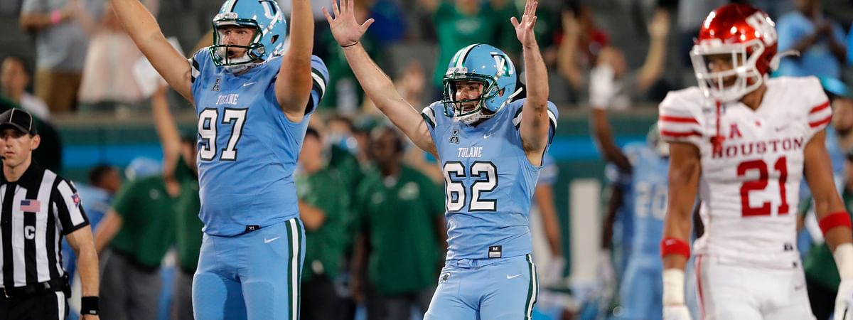 Tulane's Merek Glover (62) celebrates a go-ahead field goal with holder Ryan Wright (97) in front of Houston' Gleson Sprewell (21) during the second half of an NCAA college football game in New Orleans, Thursday, Sept. 19, 2019.