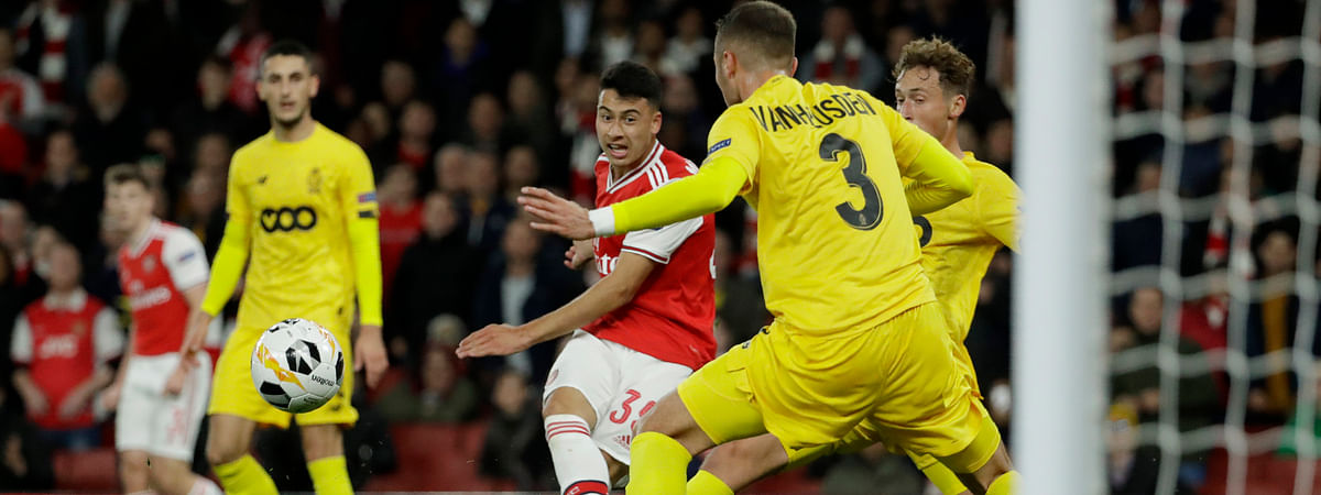 Arsenal's Gabriel Martinelli, second left, scores his side's second goal during the Europa League Group F soccer match between Arsenal and Standard Liege at the Emirates Stadium, in London, Thursday, Oct. 3, 2019.