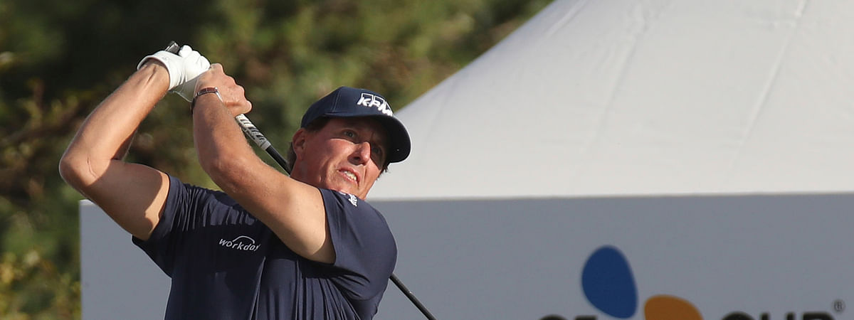 Phil Mickelson of the United States watches his shot on the 10th hole during the first round of the CJ Cup PGA golf tournament at Nine Bridges on Jeju Island, South Korea, Thursday, Oct. 17, 2019. In China this week, Mickelson is trying to finish in the Top 50 for the 26th straight year. (Park Ji-ho/Yonhap via AP)
