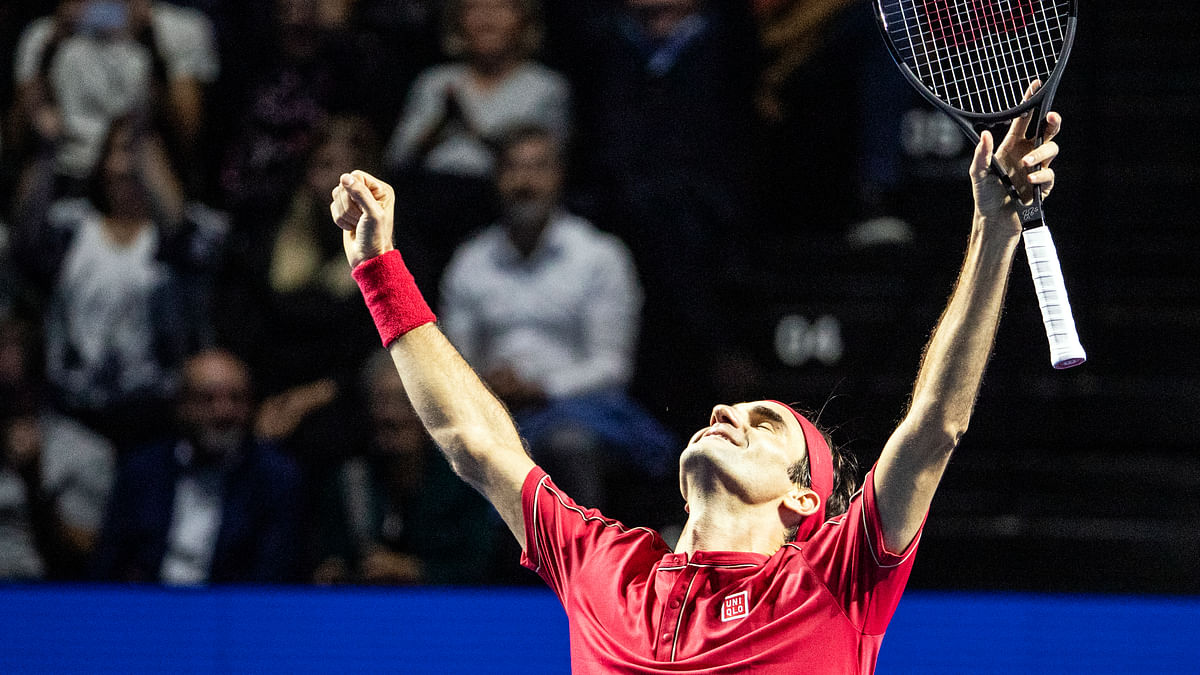 Roger Federer of Switzerland celebrates after defeating Alex De Minaur of Australia during their final match at the Swiss Indoors tennis tournament at the St. Jakobshalle in Basel, Switzerland, on Sunday, Oct. 27, 2019. ()