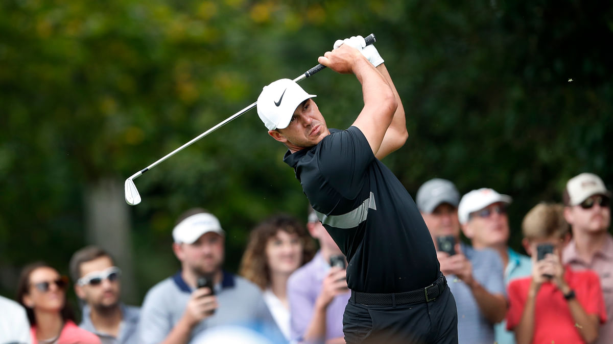 In this Aug. 25, 2019 photo, Brooks Koepka hits from the second tee during the final round of the Tour Championship golf tournament at East Lake Golf Club in Atlanta.