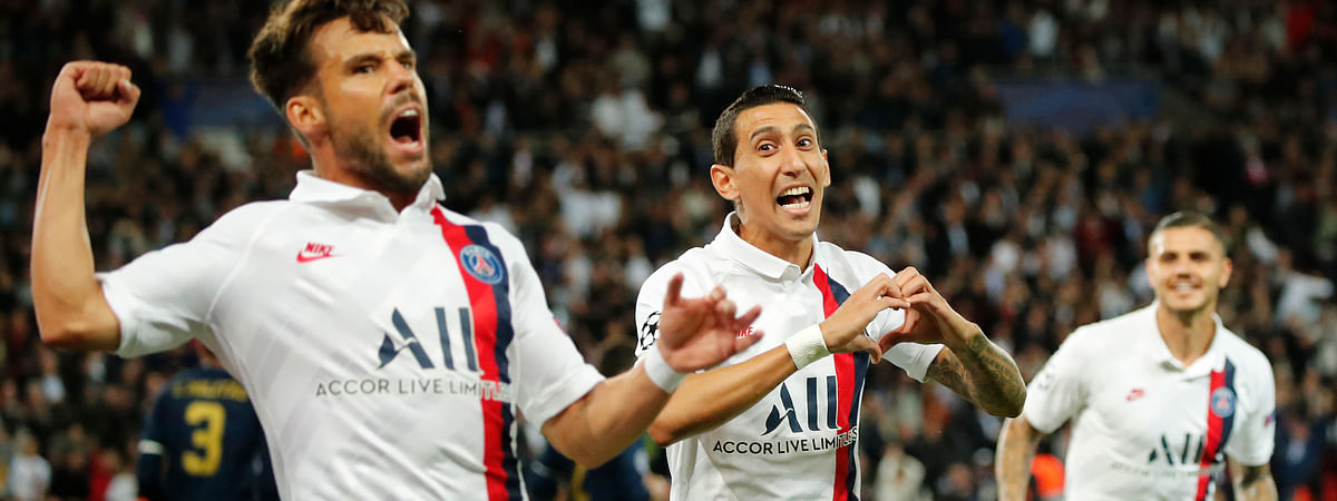 PSG's Angel Di Maria, center, celebrates with his teammates PSG's Juan Bernat, left, and PSG's Mauro Icardi after scoring his side's opening goal during the Champions League group A soccer match between PSG and Real Madrid at the Parc des Princes stadium in Paris, Wednesday, Sept. 18, 2019.