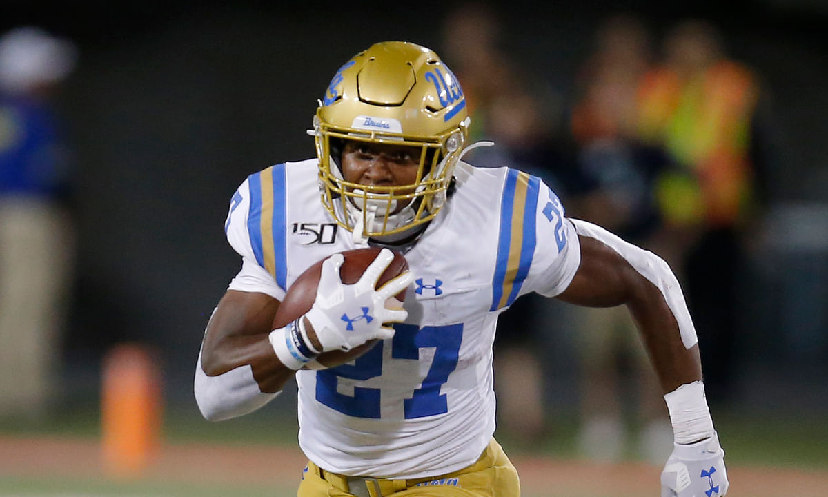 UCLA running back Joshua Kelley (27) runs for a first down against Arizona in the second half during an NCAA college football game, Saturday, Sept. 28, 2019, in Tucson, Ariz. Arizona defeated UCLA 20-17.