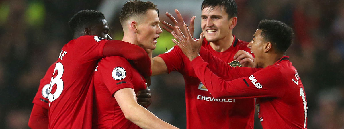Manchester United players celebrate after Manchester United's Scott McTominay, centre, scored his side's opening goal during the English Premier League soccer match between Manchester United and Arsenal at Old Trafford in Manchester, England, Monday, Sept. 30, 2019.