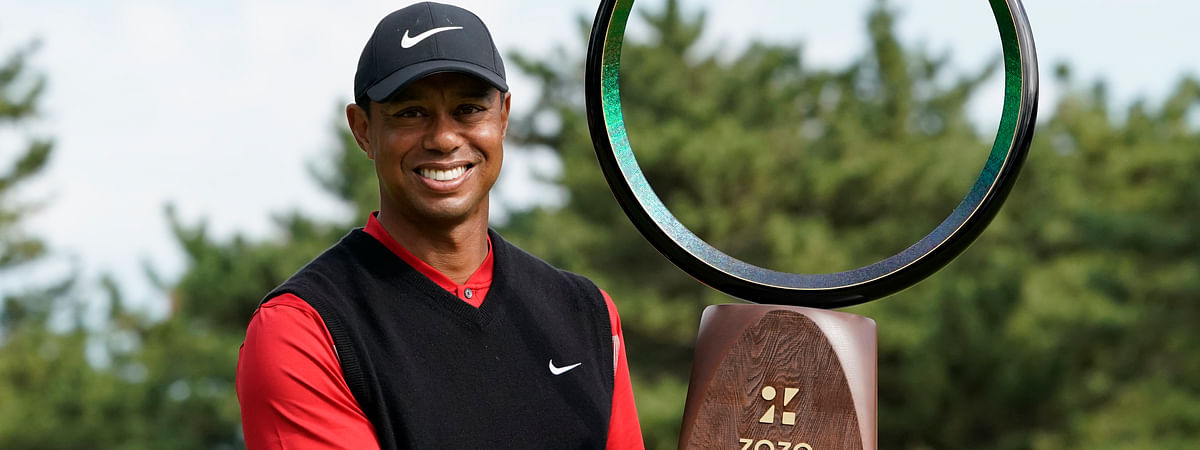 Tiger Woods of the United States poses with his trophy after winning the Zozo Championship PGA Tour at the Accordia Golf Narashino country club in Inzai, east of Tokyo, Japan, Monday, Oct. 28, 2019.