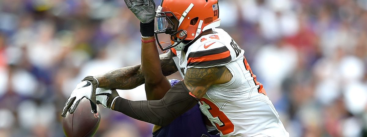 Baltimore Ravens cornerback Marlon Humphrey (44) disrupts a pass intended for Cleveland Browns wide receiver Odell Beckham (13) during the second half of an NFL football game Sunday, Sept. 29, 2019, in Baltimore.