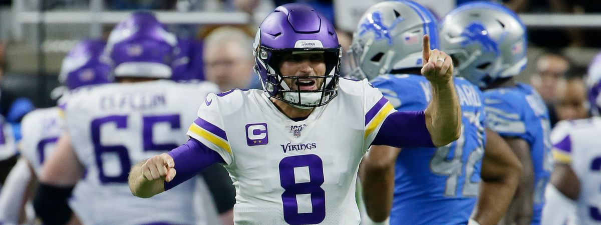 Minnesota Vikings quarterback Kirk Cousins (8) reacts after a touchdown by running back Dalvin Cook during the second half of an NFL football game against the Detroit Lions, Sunday, Oct. 20, 2019, in Detroit.