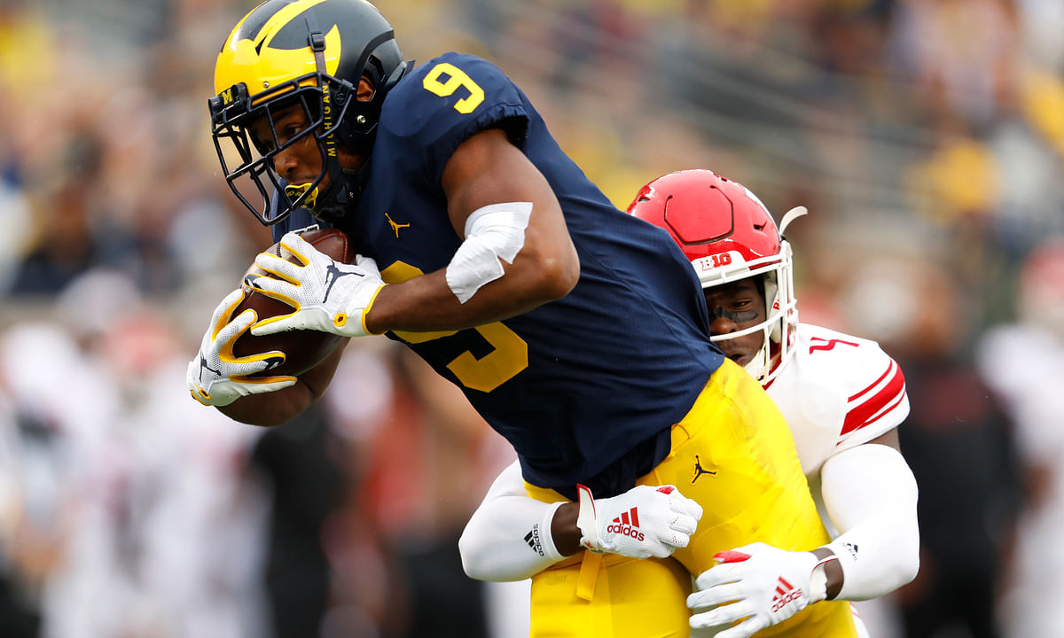 Michigan wide receiver Donovan Peoples-Jones (9) tries to break the tackle of Rutgers defensive back Tre Avery (4) in the first half of an NCAA college football game in Ann Arbor, Mich., Saturday, Sept. 28, 2019. (AP Photo/Paul Sancya)