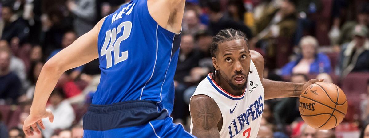 Los Angeles Clippers' Kawhi Leonard (2) drives against Dallas Mavericks' Maxi Kleber (42) back when fans were allowed to attend games.