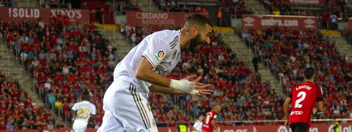 Real Madrid's Karim Benzema reacts during the Spanish La Liga soccer match between Mallorca and Real Madrid at the Iberostar Estadi in Palma de Mallorca, Spain, Saturday, Oct. 19, 2019. (AP Photo/Francisco Ubilla)