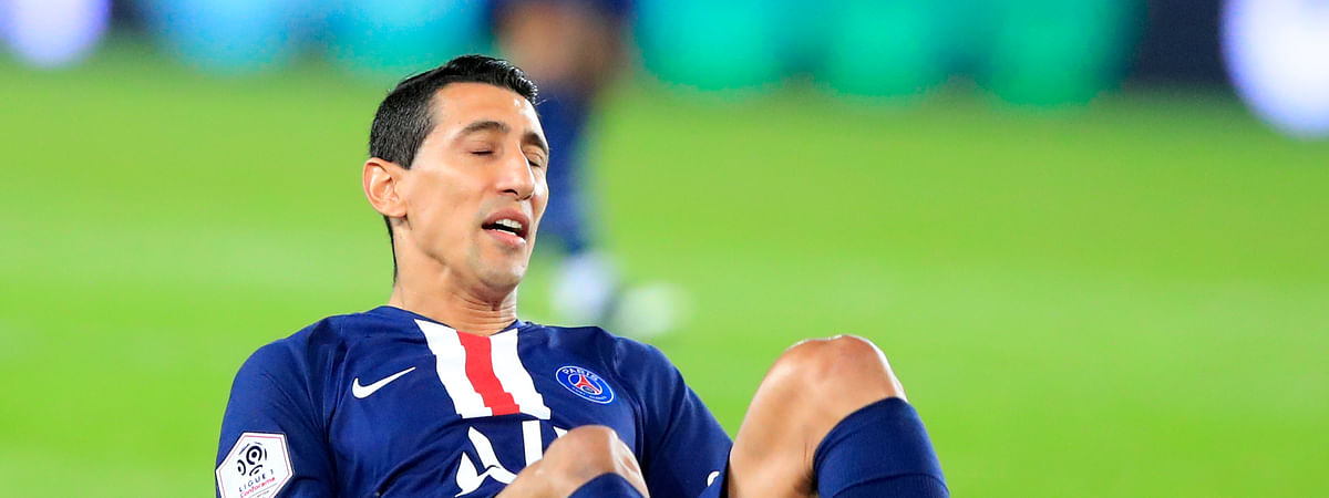 PSG's Angel Di Maria falls on his back during the French League One soccer match between PSG and Reims at the Parc des Princes stadium in Paris, Wednesday, Sept. 25, 2019. (AP Photo/Michel Euler)
