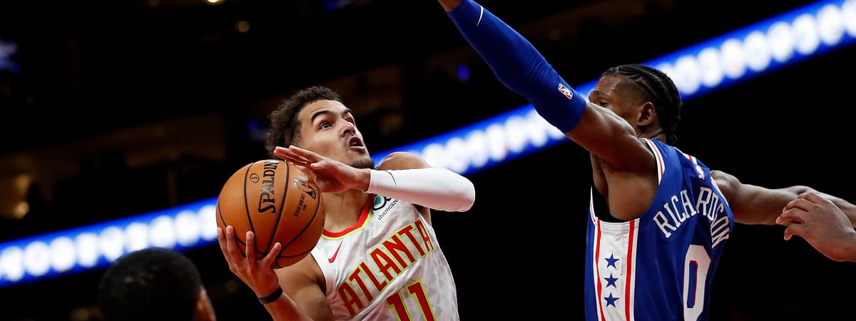 Atlanta Hawks guard Trae Young (11) goes up to shoot as Philadelphia 76ers guard Josh Richardson (0) defends in the first half of an NBA basketball game Monday, Oct. 28, 2019, in Atlanta. (AP Photo/John Bazemore)