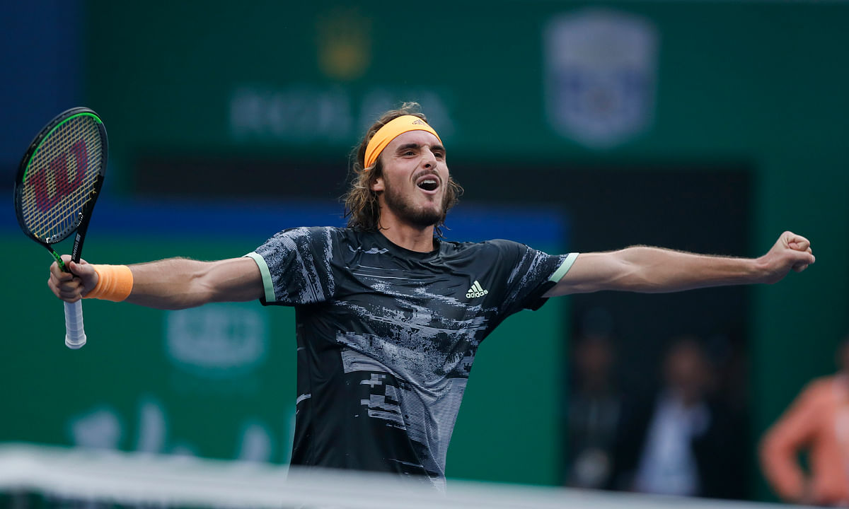 Stefanos Tsitsipas of Greece celebrates after defeating Novak Djokovic of Serbia in the men's singles quarterfinals match at the Shanghai Masters tennis tournament at Qizhong Forest Sports City Tennis Center in Shanghai, China, Friday, Oct. 11, 2019.