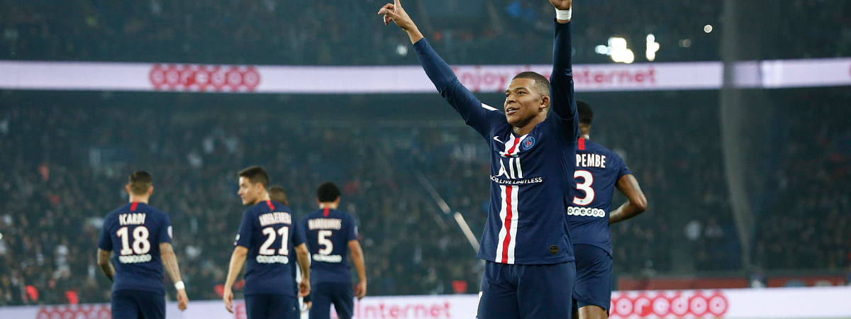 PSG's Kylian Mbappe celebrates after scoring his side goal during the French League One soccer match between PSG and Marseille at the Parc des Princes stadium in Paris, France, Sunday, Oct. 27, 2019.