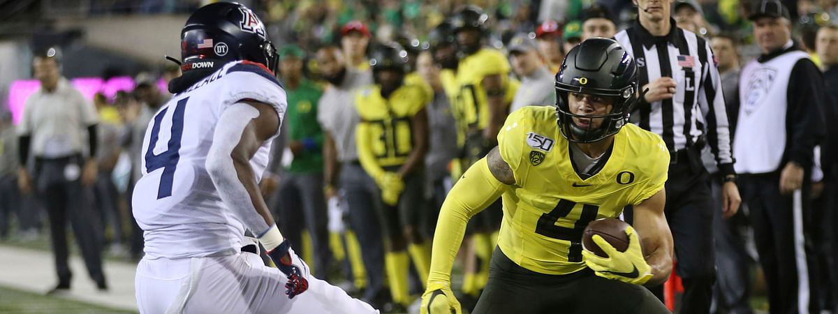 Oregon's Mycah Pittman, right, looks for extra yards against Arizona's Christian Roland-Wallace, left, after a pass reception during the first half of an NCAA college football game Saturday, Nov. 16, 2019, in Eugene, Ore.