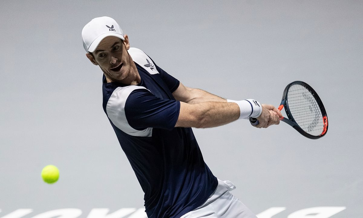 Great Britain's Andy Murray returns the ball to Netherlands' Tallon Griekspoor during their Davis Cup tennis match in Madrid, Spain, Wednesday, Nov. 20, 2019.