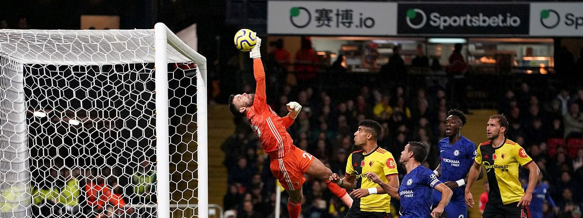 Watford goalkeeper Ben Foster saves a shot on goal from Chelsea's Tammy Abraham, second right, during the English Premiership League soccer match at Vicarage Road, Watford, England, Saturday Nov. 2, 2019.