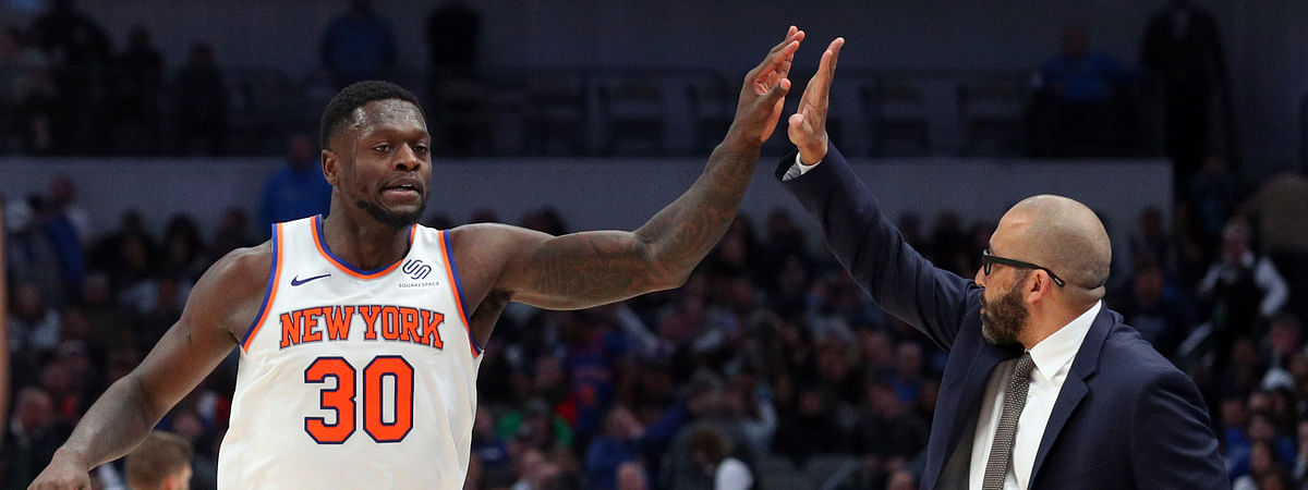 New York Knicks forward Julius Randle (30) high-fives New York Knicks head coach David Fizdale near the end of an NBA basketball game against the Dallas Mavericks, Friday, Nov. 8, 2019, in Dallas. (AP Photo/Richard W. Rodriguez)