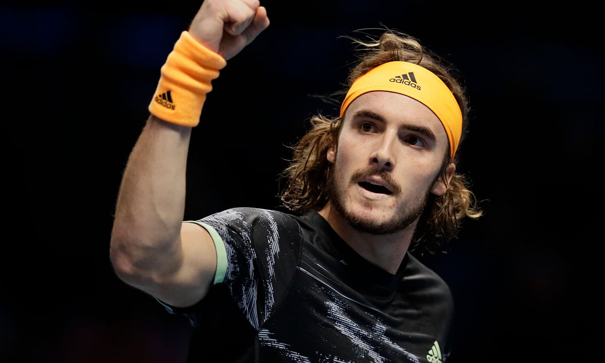 Stefanos Tsitsipas of Greece celebrates winning a point against Daniil Medvedev of Russia during their ATP World Tour Finals singles tennis match at the O2 Arena in London, Monday, Nov. 11, 2019.