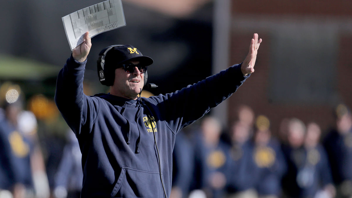 Michigan head coach Jim Harbaugh gestures toward his team during the second half of an NCAA college football game against Maryland, Saturday, Nov. 2, 2019, in College Park, Maryland.