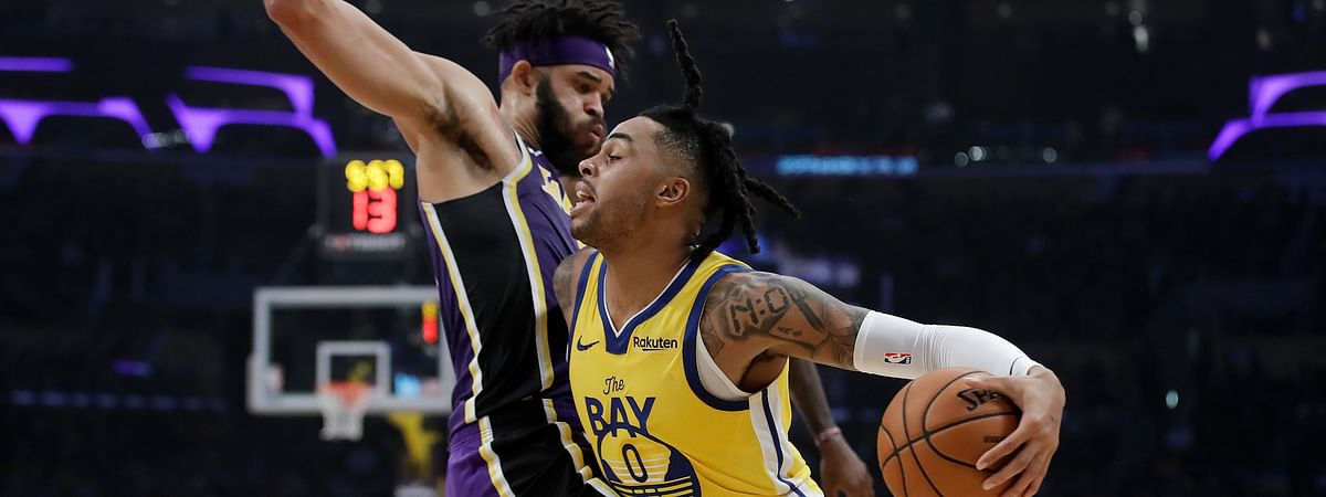 Golden State Warriors' D'Angelo Russell (0) is defended by Los Angeles Lakers' JaVale McGee during the first half of an NBA basketball game Wednesday, Nov. 13, 2019, in Los Angeles.