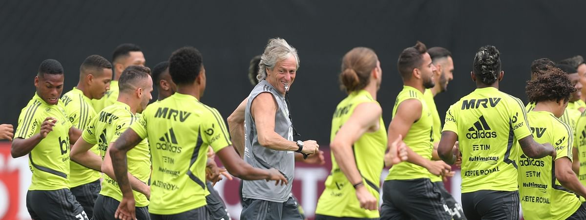 Brazil's Flamengo Coach Jorge Jesus, center, runs with his players during a training session on the pitch of the Peruvian Soccer Federation, in Lima, Peru, Friday, Nov. 22, 2019. Flamengo will play Argentina's River Plate in the Copa Libertadores final match on Saturday. (AP Photo/Martin Mejia)