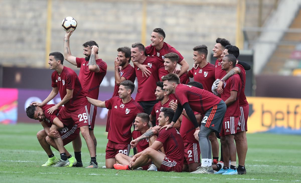 Argentina's River Plate players photo at on the pitch at the Monumental Stadium during a training session in Lima, Peru, Friday, Nov. 22, 2019. River Plate will play Brazil's Flamengo on Saturday, in the Copa Libertadores final match. (AP Photo/Martin Mejia)