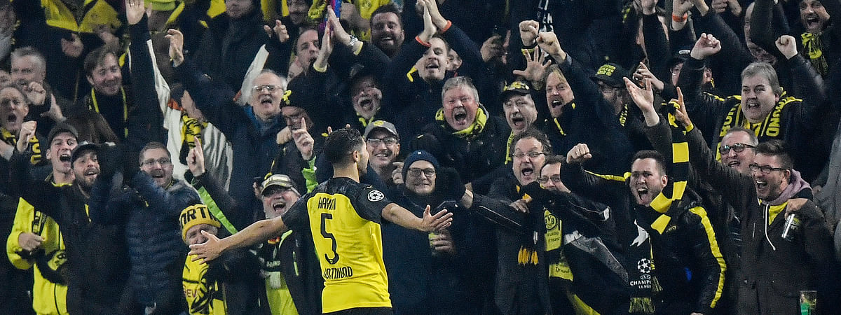 Dortmund's Achraf Hakimi celebrates after scoring his side's third goal during the Champions League group F soccer match between Borussia Dortmund and Inter Milan, in Dortmund, Germany, Tuesday, Nov. 5, 2019. Dortmund defeated Inter with 3-2. (AP Photo/Martin Meissner)