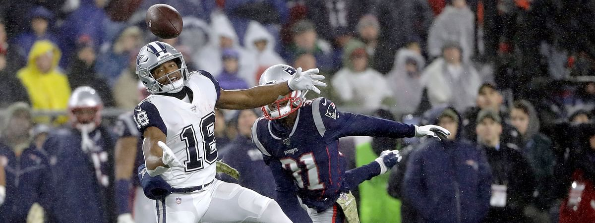 Dallas Cowboys wide receiver Randall Cobb can't catch a pass as New England Patriots defensive back Jonathan Jones, rear, defends in the first half of an NFL football game, Sunday, Nov. 24, 2019, in Foxborough, Mass.