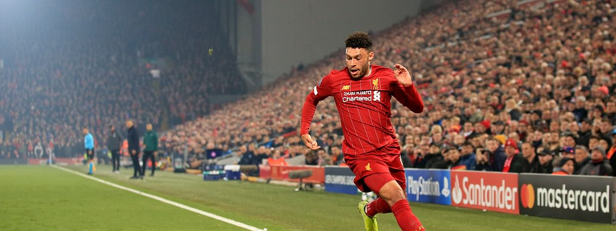 Liverpool's Alex Oxlade-Chamberlain runs with the ball during the Champions League group E soccer match between Liverpool and Genk at Anfield Stadium, Liverpool, England, Tuesday, Nov. 5, 2019.