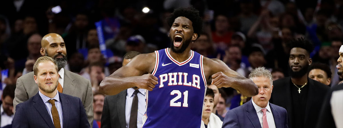 Philadelphia 76ers' Joel Embiid reacts after it was announced that he and Minnesota Timberwolves' Karl-Anthony Towns were ejected, during the second half of an NBA basketball game Wednesday, Oct. 30, 2019, in Philadelphia. The 76ers won 117-95.