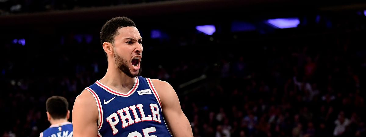 Philadelphia 76ers guard Ben Simmons (25) celebrates his dunk against the New York Knicks during the second half of an NBA basketball game Friday, Nov. 29, 2019, in New York. (AP Photo/Steven Ryan)