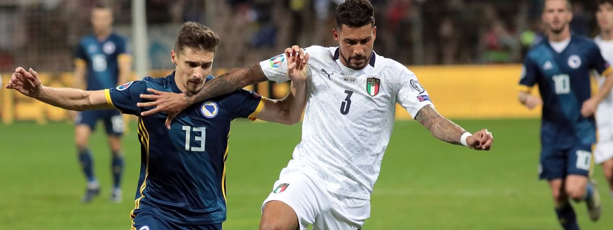Italy's Emerson, right, duels for the ball with Bosnia's Gojko Cimirot during the Euro 2020 group J qualifying soccer match between Bosnia-Herzegovina and Italy at the Bilino polje stadium in Zenica, Bosnia, Friday, Nov. 15, 2019.