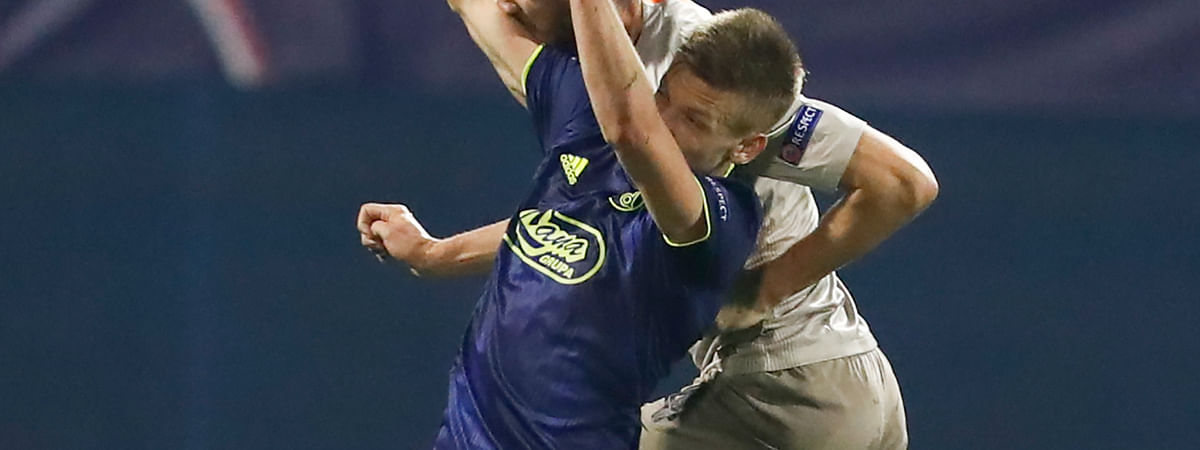 Dinamo Zagreb's Dani Olmo, left, and Shakhtar's Serhiy Kryvtsov head the ball during the Champions League soccer match between Dinamo Zagreb and Shakhtar Donetsk on Nov. 6, 2019. Spain coach Robert Moreno called up the 21-year-old Dani Olmo for a pair of European Championship qualifying matches.