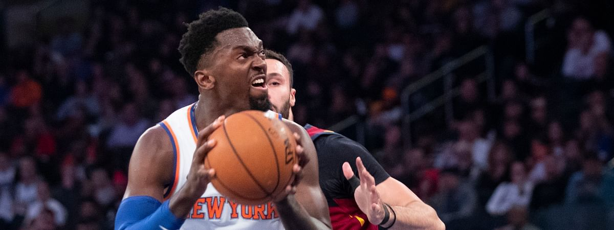 New York Knicks center Bobby Portis (1) goes to the basket as Cleveland Cavaliers forward Larry Nance Jr. defends during the first half of an NBA basketball game Sunday, Nov. 10, 2019, at Madison Square Garden in New York. (AP Photo/Mary Altaffer)