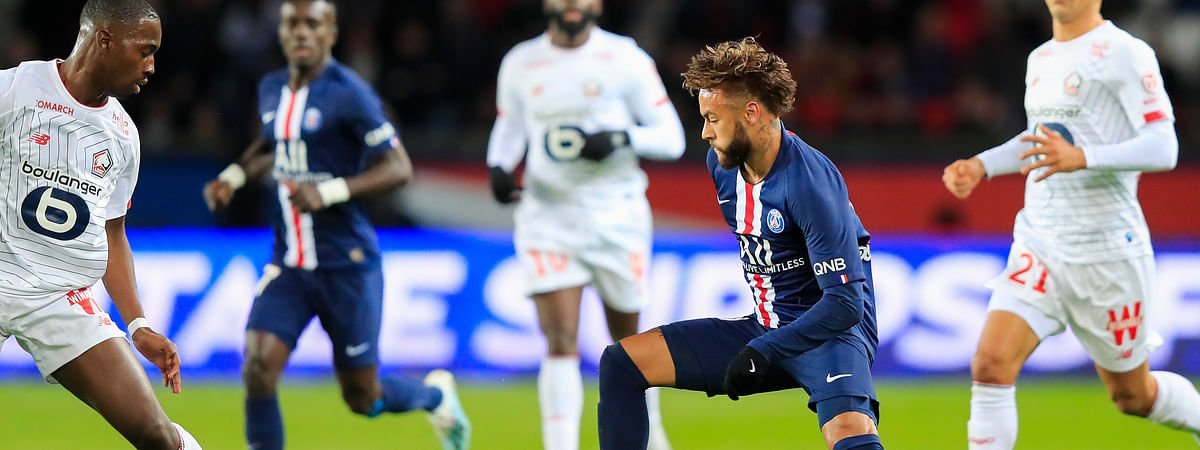 PSG's Neymar, center, vies for the ball with Lille's Boubakary Soumare, left, during French League One soccer match between Paris Saint-Germain and Lille at the Parc des Princes stadium in Paris, Friday, Nov. 22, 2019.