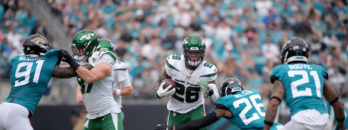 FILE - In this Oct. 27, 2019, file photo, New York Jets running back Le'Veon Bell (26) rushes for yardage in front of Jacksonville Jaguars defensive back Jarrod Wilson (26), defensive end Yannick Ngakoue (91) and cornerback A.J. Bouye (21) during the first half of an NFL football game in Jacksonville, Fla.  (AP Photo/Phelan M. Ebenhack, File)
