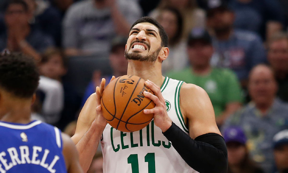 Boston Celtics center Enes Kanter, right, reacts after a foul was called against his team during the second half of an NBA basketball game against the Sacramento Kings in Sacramento, Calif., Sunday, Nov. 17, 2019.