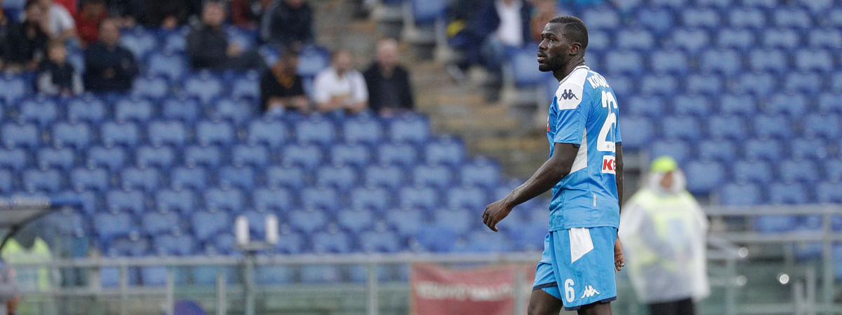 Napoli's Kalidou Koulibaly walks the pitch as the match was briefly suspended because fans were making racist chants against him, during an Italian Serie A soccer match between Roma and Napoli, at the Olympic stadium in Rome, Saturday, Nov. 2, 2019.