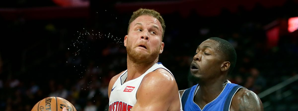 Detroit Pistons forward Blake Griffin (23) goes to the basket against Dallas Mavericks forward Dorian Finney-Smith (10) during the first half of an NBA preseason basketball game Wednesday, Oct. 9, 2019, in Detroit.